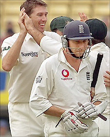 Michael Atherton (front) trudges off after being dimissed by Glenn McGrath (left) again
