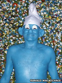 Stephen Parkes surrounded by smurfs