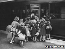 Evacuee children, pictured here at the station, preparing to leave London for the safety of the countryside