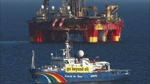 Greenpeace boat in front of oil rig off Greenland