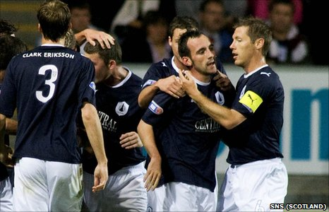 Mark Stewart (2nd right) is congratulated by his team mates after firing Falkirk into the lead