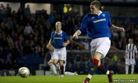 Kyle Lafferty scores a goal for Rangers against Dunfermline