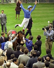 Frankie Dettori performs a flying dismount