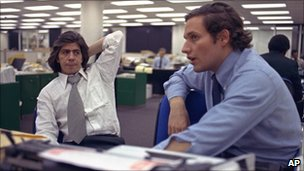 Reporters Bob Woodward, right, and Carl Bernstein, sit in the newsroom of the Washington Post, May 7, 1973