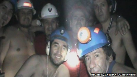 some of the trapped Chilean miners, smiling to the video camera, looking fit, healthy, and fine, after over forty days underground. Sept. 17th