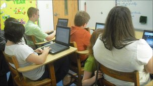 Students at Trinity Christian School using the broadband access to study in class