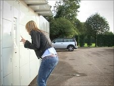 Woman picking up a parcel sent by Send Social