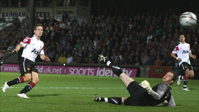 Manchester United's Michael Owen scores in the League Cup