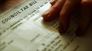 Woman studying a council tax bill