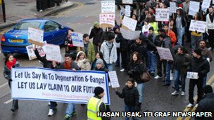 People marching through the streets of north London
