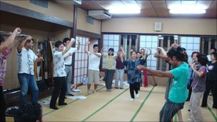 Students at Byron Fija's class practise a traditional Okinawan farewell dance
