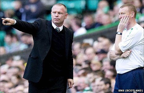 Hibs manager John Hughes and assistant Brian Rice (right)