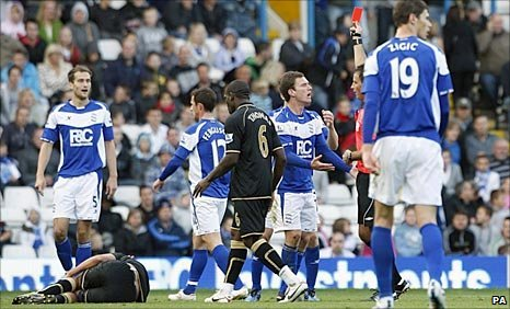 Franco Di Santo lies injured on the left of picture as Craig Gardner is shown the red card