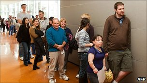 Aspiring film extras queue during an audition to be part of The Hobbit movies