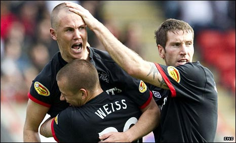 Kenny Miller celebrates with Vladimir Weiss and Kirk Broadfoot