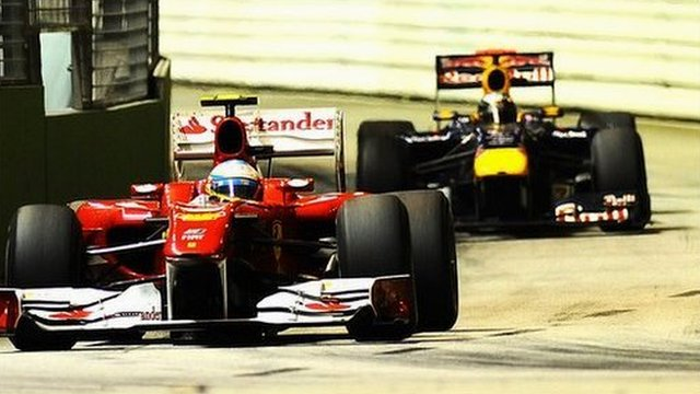 Ferrari driver Fernando Alonso with Red Bull&amp;apos;s Sebastian Vettel just behind him at the Singapore Grand Prix