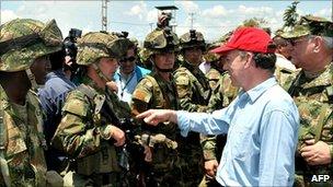 President Juan Manuel Santos meeting soldier who took part in the operation that killed Farc rebel leader Mono Jojoy