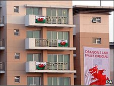 Wales flags adorn balconies in the Commonwealth Games village