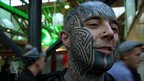 Man with tattooed head.