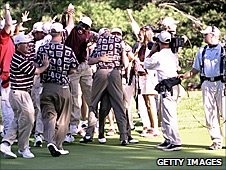The US team celebrate Justin Leonard's 45-foot putt on the 17th green