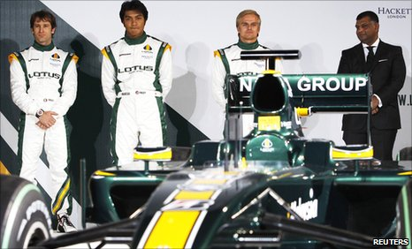 Drivers Jarno Trulli (left), Fairuz Fauzy (second left), Heikki Kovalainen and Team Principal Tony Fernandes pose with the Lotus T127