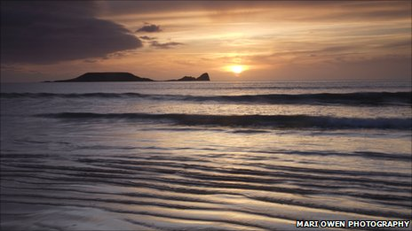 Worm's Head seen from Rhossili beach. Pic: Mari Owen Photography
