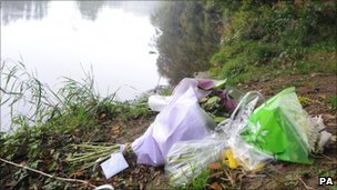 Flowers left next to the River Wharfe where Jimi Heselden died