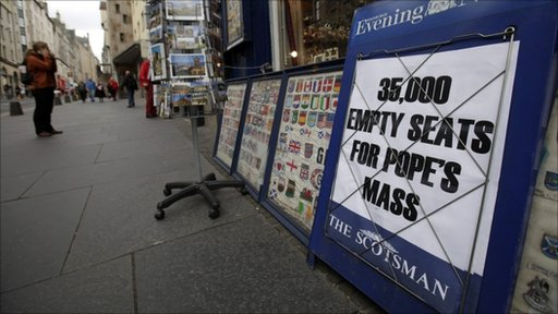 A banner advertises an edition of a local newspaper in central Edinburgh