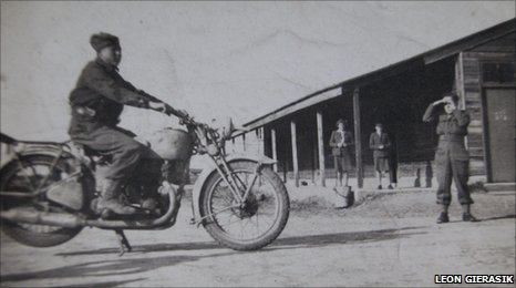 Leon Gierasik on a despatch rider's bike in Italy during WWII