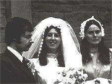 Groom, bride and bridesmaid