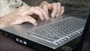 Man typing on laptop computer - generic image