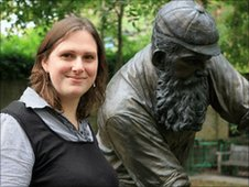 Emma Peplow with a statue of WG Grace