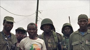 Ecomog soldiers with rebel loyal to Charles Taylor in Liberia in 1992