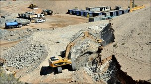 Excavators building a platform for journalists expected to cover the rescue of the trapped Chilean miners, 28 September