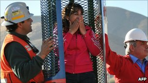 Carolina Lobos, daughter of Franklin Lobos, one of the 33 miners trapped in San Jose mine, checks the capsule