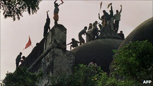The Babri mosque being torn down by a mob in December 1992