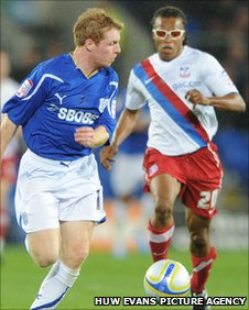 Cardiff's Chris Burke tries to get away from Palace's Edgar Davids