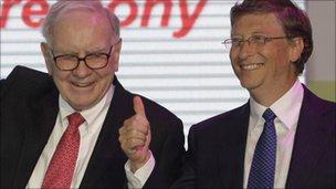 US billionaires Bill Gates (R) and Warren Buffett