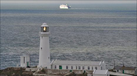South Stack lighthouse on Anglesey with a ferry crossing the Irish Sea in the background Photo: Gareth Roberts
