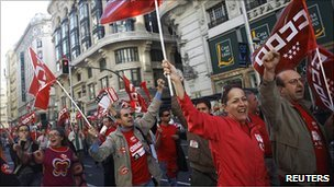 Picketers wave union flags on Madrid's Gran Via boulevard