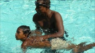 An older child is taught to swim at the IDRC
