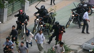 Iranian riot police beat anti-government protesters in Tehran (14 June 2009)