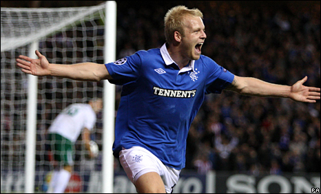 Steven Naismith celebrates giving Rangers the lead at Ibrox