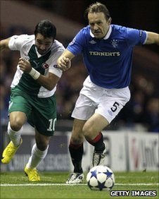 Bursapors Volkan Sen vies with Rangers Bosnian defender Sasa Papac for possession