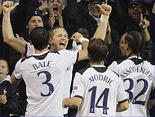 Roman Pavlyuchenko (second left) is congratulated by team-mates after scoring for Spurs against FC Twente