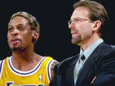 Rambis (right) had a brief spell coaching the Lakers and rebellious foirward Dennis Rodman