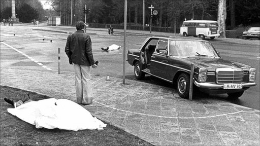 Crime scene with the covered corpses of federal prosecutor Siegfried Buback and his driver on April 7, 1977