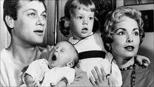 Tony Curtis and Janet Leigh with daughters Kelly and Jamie Lee 