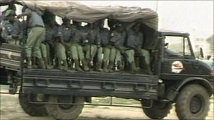 Soldiers in a military vehicle