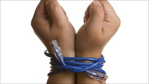 Hands bound by ethernet cable (Thinkstock)